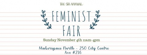 """Image says """"5th Annual Feminist Fair"""" with the text surrounded by a floral wreath."""